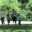 Family running in slow motion together — Stock Video