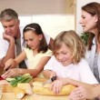 Stock Video: Happy family preparing a meal together