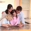 Family looking at a tablet pc — Stockvideo