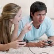 Woman winning in a video game against her boyfriend — Stock Video #23694659