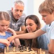 Stock Video: Family playing chess