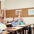Cheerful pupils raising their fingers — Stock Video #23695659