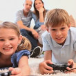 Smiling siblings playing video games — Stock Video #23696585