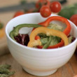 Tomatoes dropping in super slow motion into salad — Stock Video #23697371