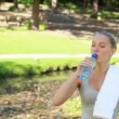 Woman resting takes a drink — Stock Video
