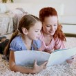 Mother and daughter reading a book — Stock Video #23697411