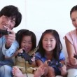 Family happily playing a games console together — Stock Video