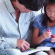 Father helping his daughter to do her homework — Stock Video