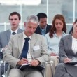 Business people taking notes — Stock Video #23699869