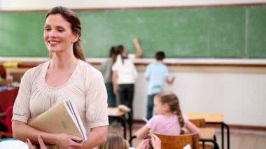 Happy teacher standing upright — Stock Video