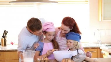 Little girl breaking eggs with her family — Stock Video