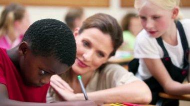 Teacher talking to a pupil — Vidéo