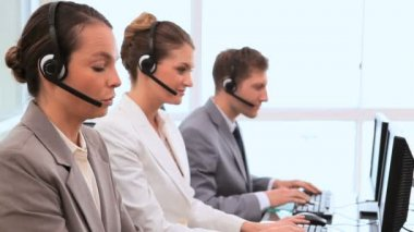 Call centre agents working with computers — Stock Video