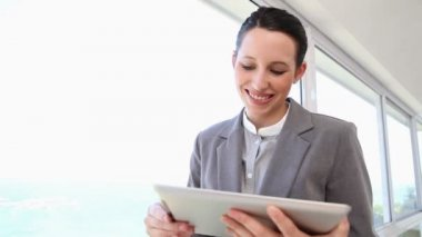Businesswoman using a touch pad — Stock Video