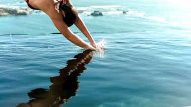 Woman diving into the water in slow motion — Stock Video