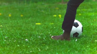 Soccer ball in slow motion being kicked — Stock Video
