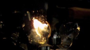 Activated bulb getting crushed in super slow motion — Stock Video