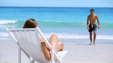 Young woman sunbathing — Stock Video