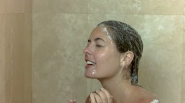 Woman showering in slow motion — Stock Video