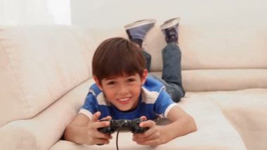 Boy playing videos games — Stock Video