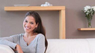 Smiling brunette relaxing — Stock Video