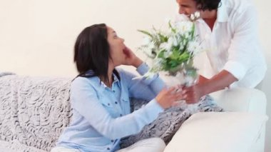 Woman getting surprised with a bouquet from her boyfriend — Stock Video
