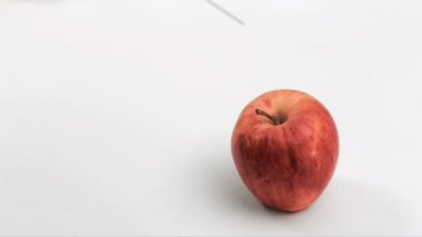 Red apple in super slow motion being modified — Vídeo Stock