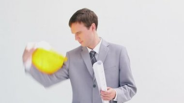 Serious businessman holding blueprints — Stock Video