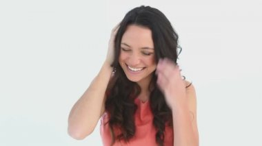 A girl laughs while rubbing her head — Stock Video