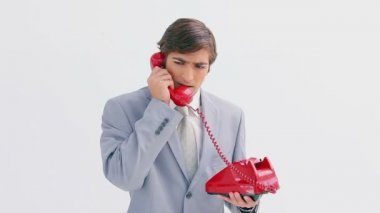 Serious man picking up the phone — Stock Video