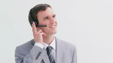Happy businessman using a headset — Stockvideo