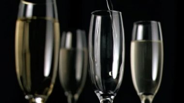 White wine flowing in super slow motion in flute — Stock Video