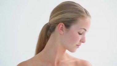 Blonde woman massaging her shoulder — Stock Video
