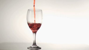 Red liquid falling in super slow motion — Stock Video