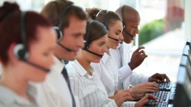 A large business team wearing headsets — Stock Video