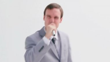 Businessman singing into a cordless microphone — Stock Video