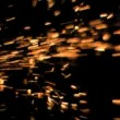 Sparks flying in super slow motion from the side — Stock Video #23700431