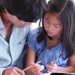 Father helping his daughter with her homework — Stock Video
