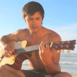 Handsome man playing guitar — Stock Video