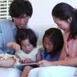 Family reading a ebook between them — Stock Video #23701559