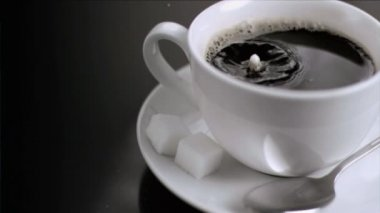 Rebound in super slow motion of a drop of milk — Stock Video