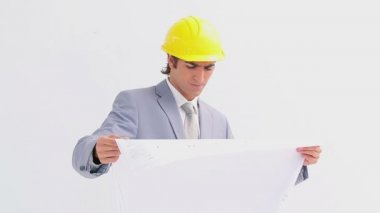 Serious businessman checking the construction work — Stockvideo