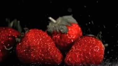 Red strawberries in super slow motion being wet — Stock Video