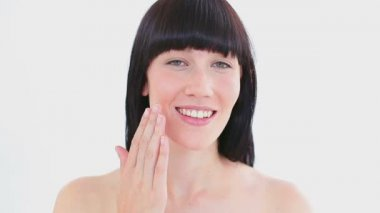 Smiling woman massaging her cheek — Stock Video