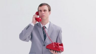 Angry businessman talking on the phone — Stock Video