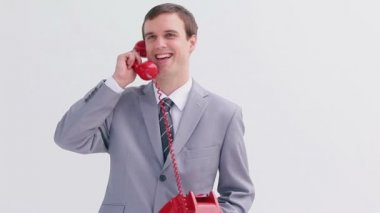 Cheerful businessman talking on the phone — Stock Video