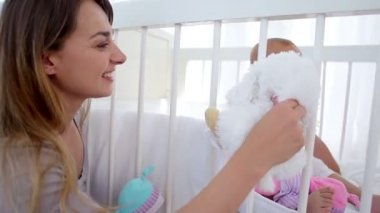 Mother giving a cuddly toy to her baby — Stock Video