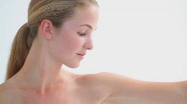 Peaceful blonde woman massaging her shoulder — Stock Video