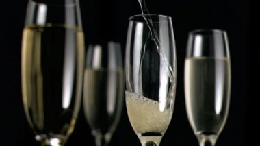 Champagne flowing in super slow motion in a glass — Stock Video