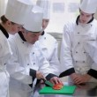 Trainee chefs learning how to slice vegetables — Stock Video
